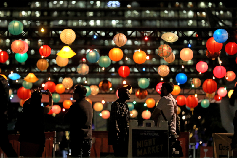 People under paper lanterns at the L.A. Times Food Bowl