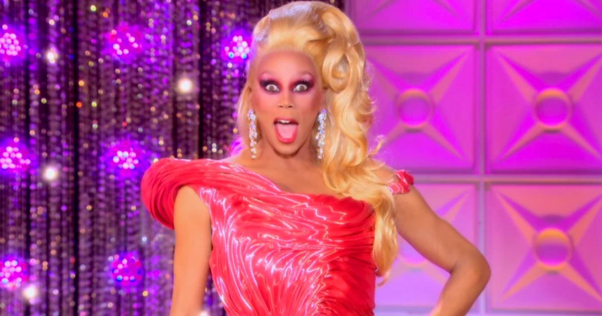 RuPaul on the runway of RuPaul's Drag Race with a shocked expression on her face