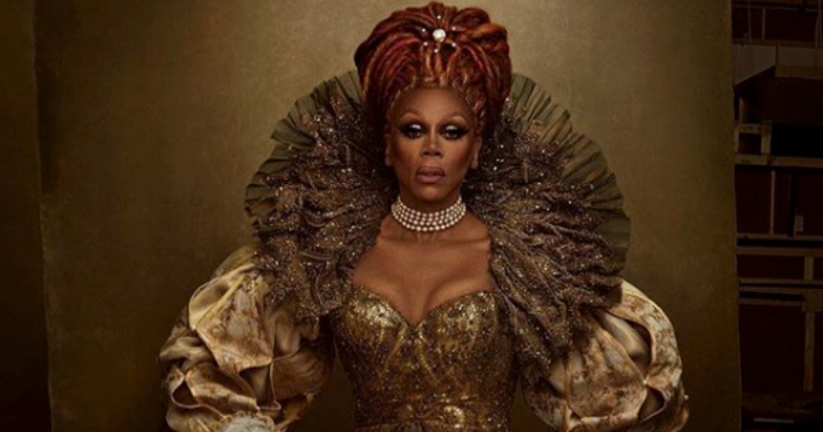 RuPaul Charles in an ornate royal getup being photographed for Vogue magazine