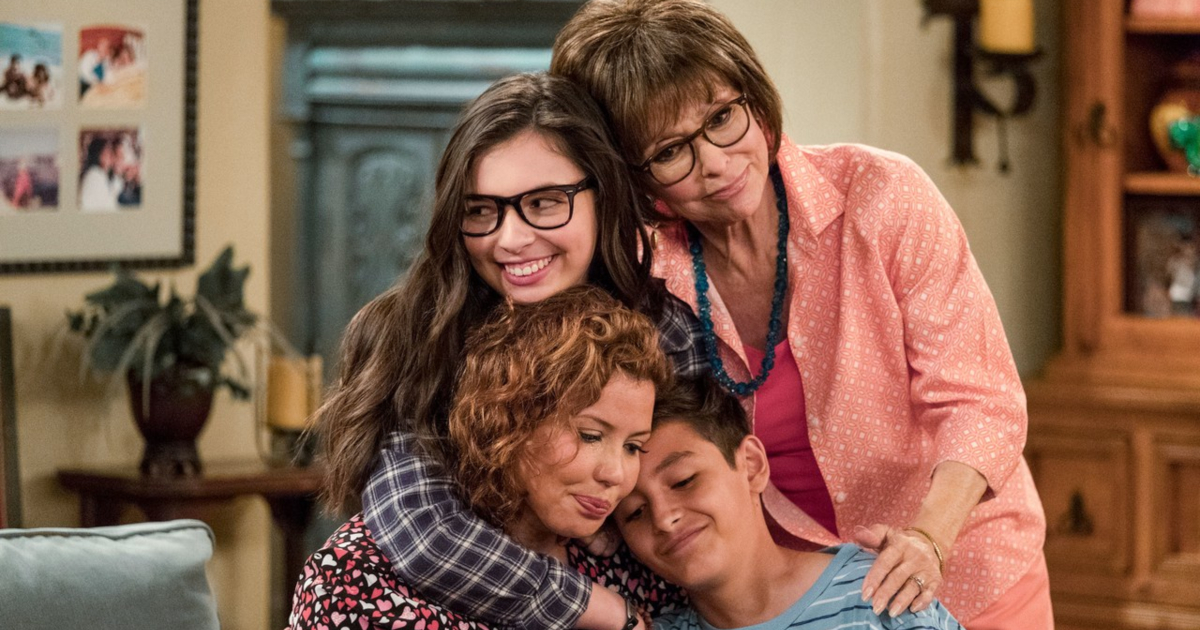 The Alvarez family hugging each other on 'One Day at a Time'