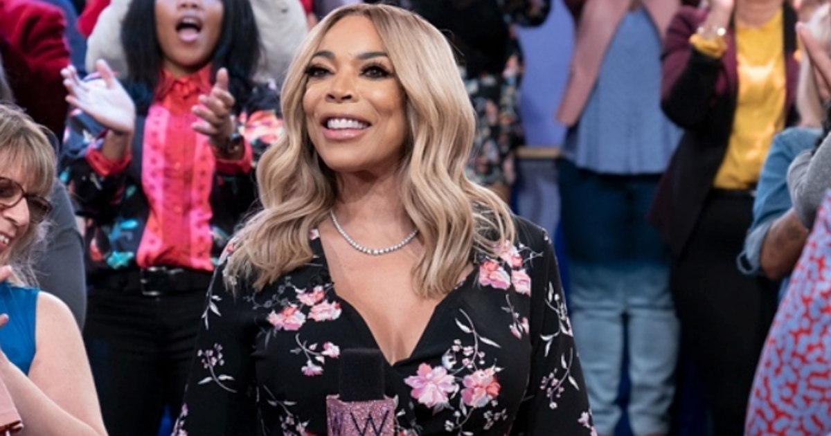 Wendy Williams posing with her microphone in front of a crowd for The Wendy Williams Show