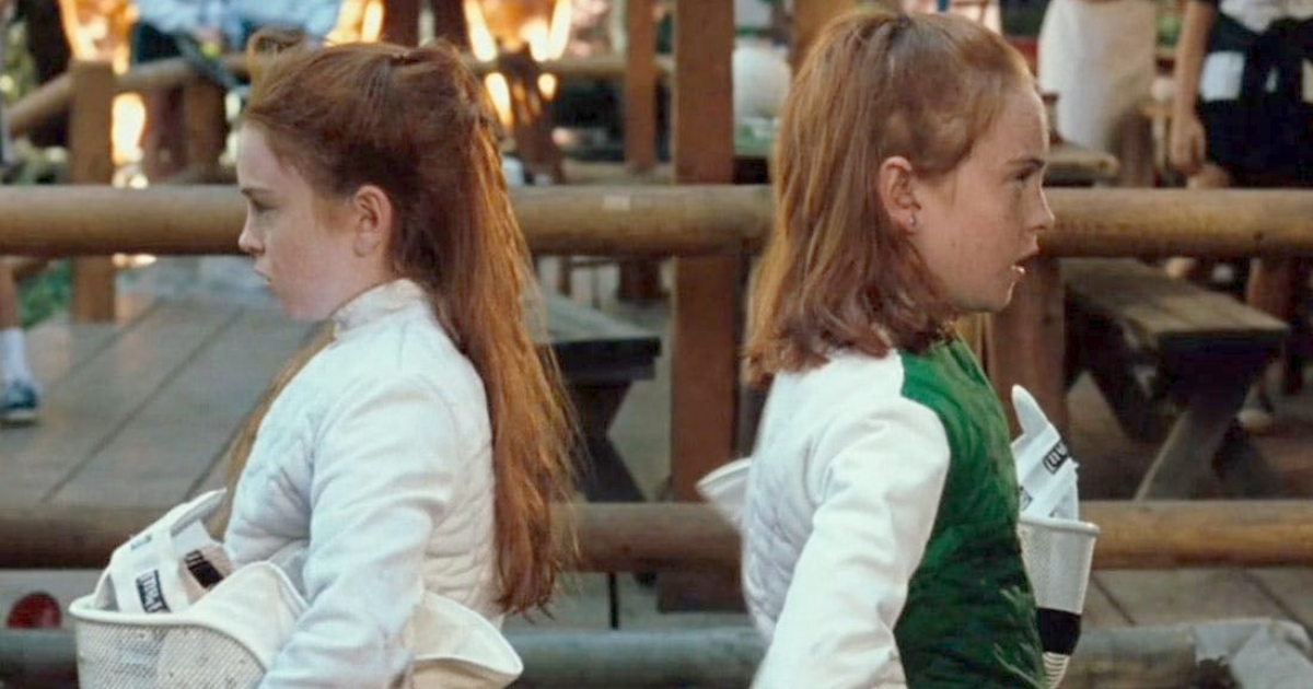 Hallie and Annie standing back to back after competing in a fencing tournament in 'The Parent Trap'