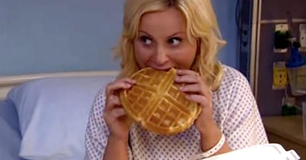 Leslie Knope biting into a waffle while she's in the hospital being treated for the flu on 'Parks and Recreation'
