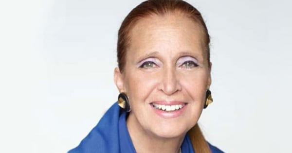 Headshot of author Danielle Steel sitting in front of a white background wearing an all blue outfit
