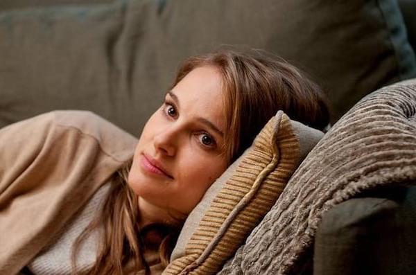 in the movie No Strings Attached, Natalie Portman laying on a pillow recuperating from her period