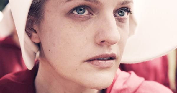 Elizabeth Moss as June in Handmaid's Tale close up in white bonnet and red outfit
