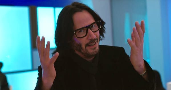 Keanu Reeves walking with his hands up in the air in 'Always Be My Maybe'
