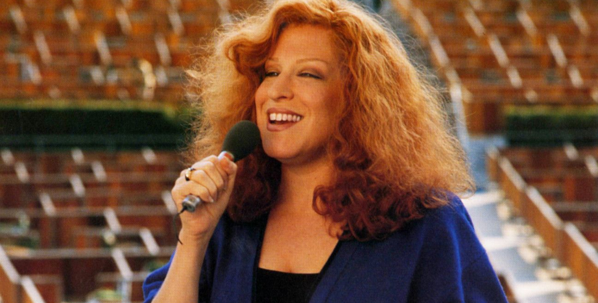 Bette Midler singing on a stage in 'Beaches'