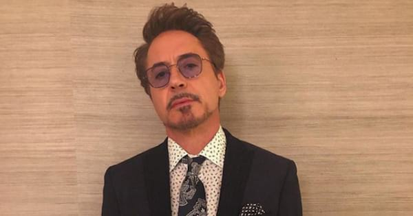 Robert Downey Jr. posing in a suit and tie for an Instagram photo