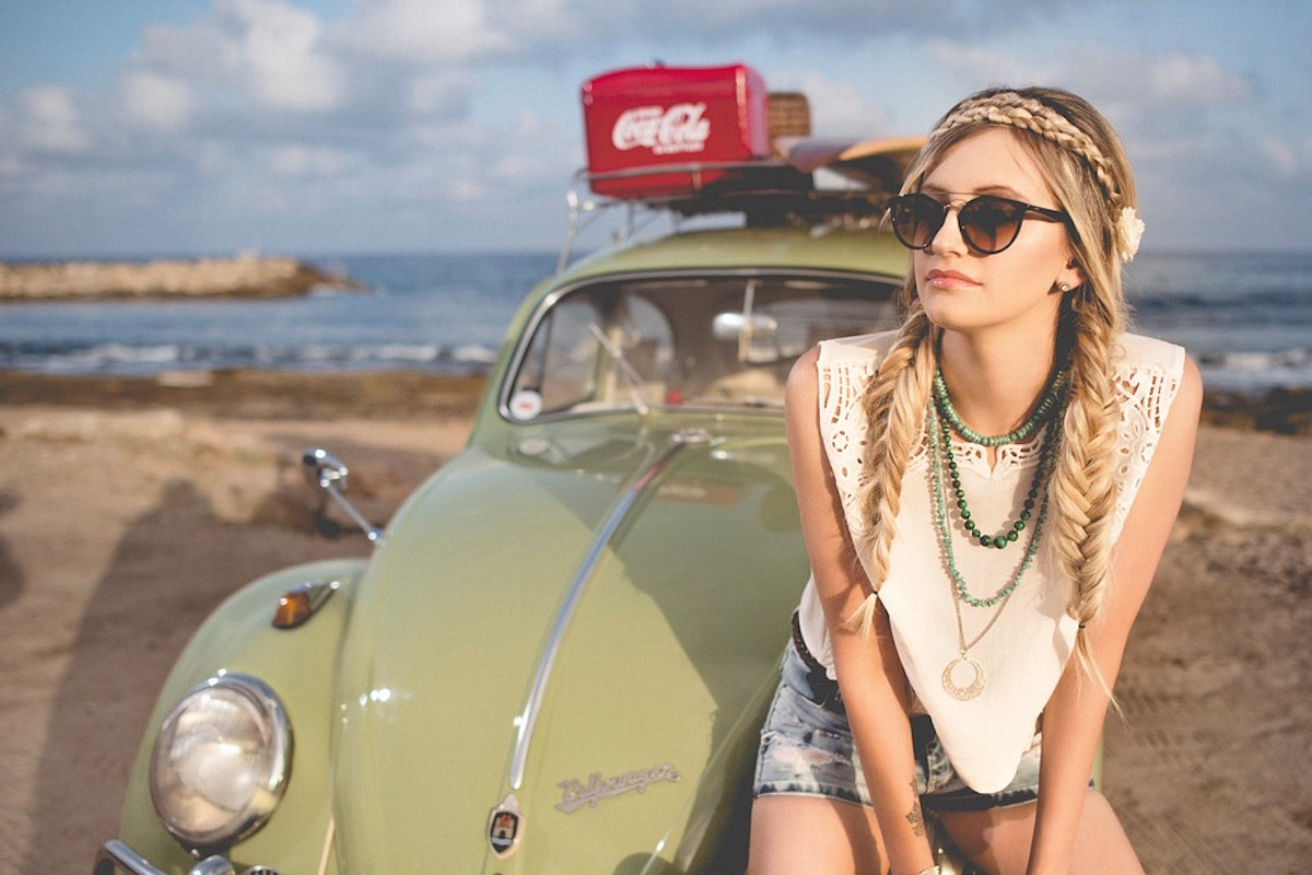 woman braids on beach with beetle smiling travel alone quotes