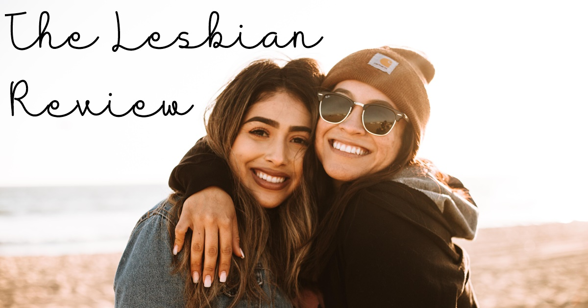 the lesbian review, lgbt book blogs, two women of color hugging on a beach, books