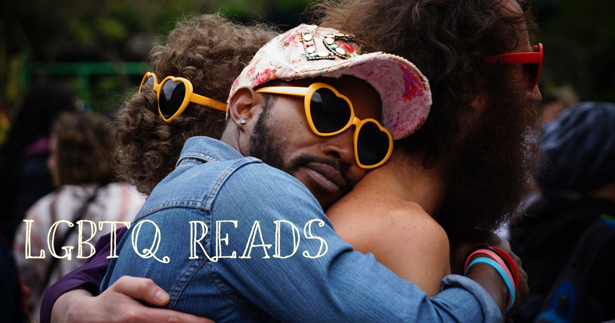 lgbt book blogs, lgbtq reads, image of a black man embracing a white man from behind, books