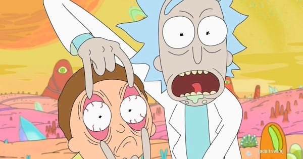 Rick holding Morty's eyes open while they're exploring another dimension on 'Rick and Morty'