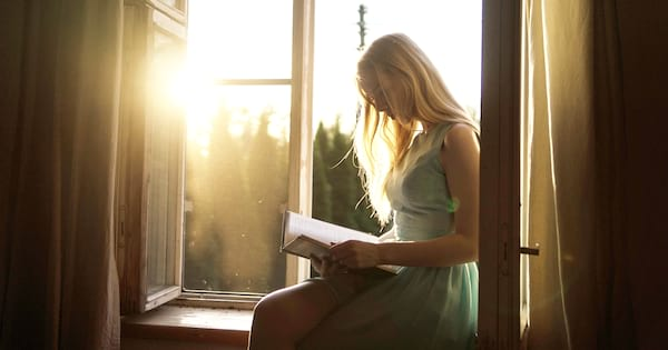 books about bipolar disorder, a white woman sitting in a window reading a book, books, health