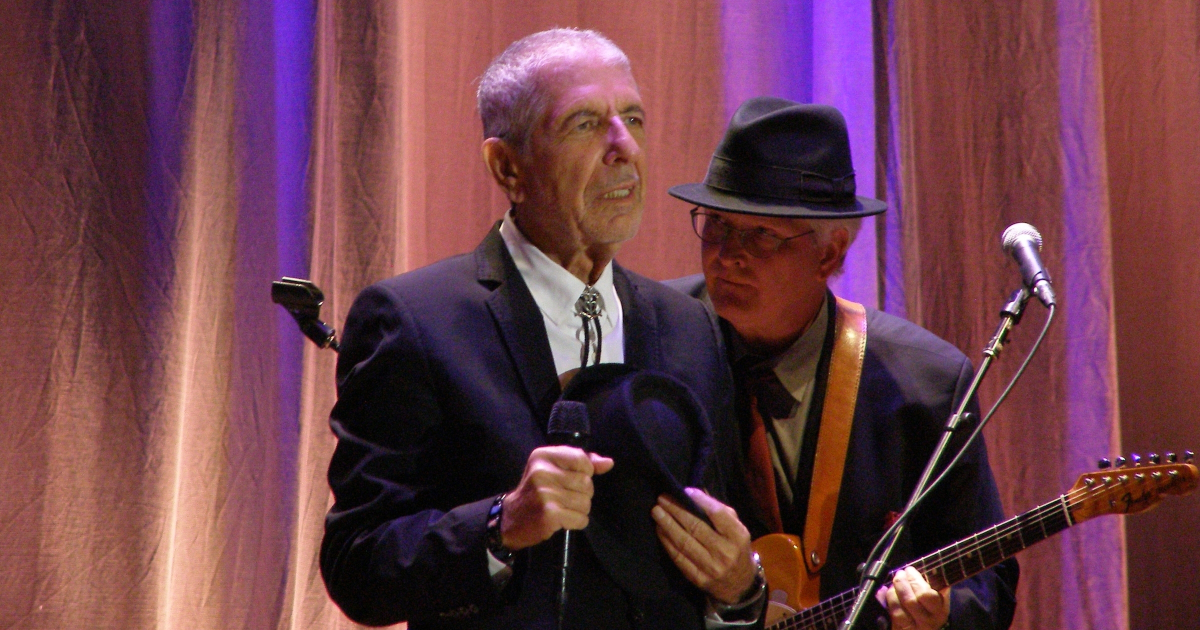 FLORENCE - SEPTEMBER 1: Leonard Cohen, backed by guitarist Bob Metzger, greets the audience of his only Italian date of the tour: Florence, piazza Santa Croce on September 1st, 2010.