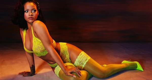 Rihanna modeling a neon yellow set of lingerie from her Savage X Fenty brand