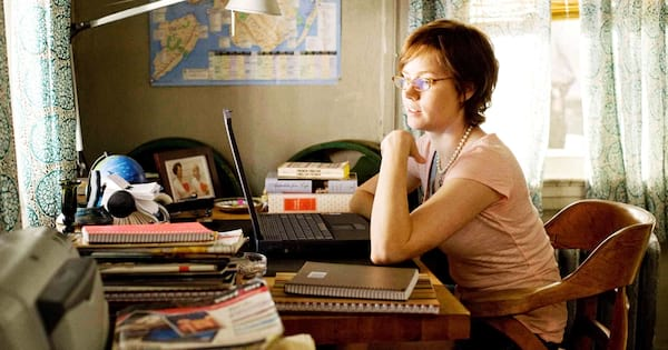 books about movies, still of julia working at her desk surrounded by books from the movie julie and julia, movies, books