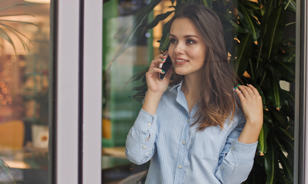 long distance romance novels, image of a white woman with brown hair talking on the phone, books
