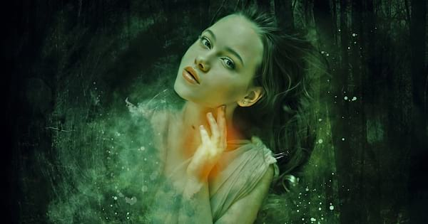 books about magic, a white woman surrounded by green sparkles and swirls, books