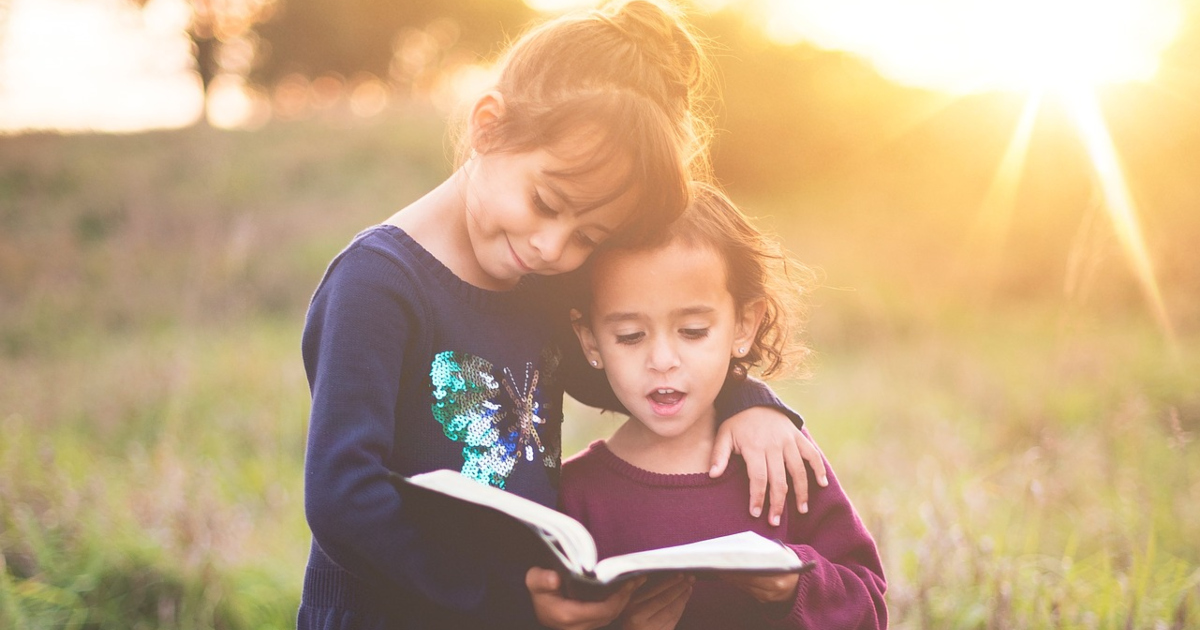 children's mystery books, two young girls standing in a field reading from a book, books