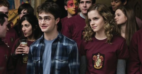 Hermione and Harry surrounded by their friends in 'Harry Potter and the Half-Blood Prince'