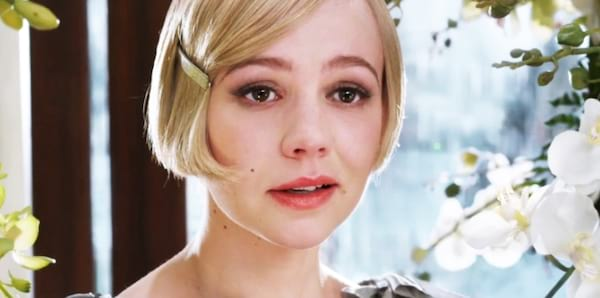 Carey Mulligan playing Daisy Buchanan in The Great Gatsby blonde hair in front of white flowers