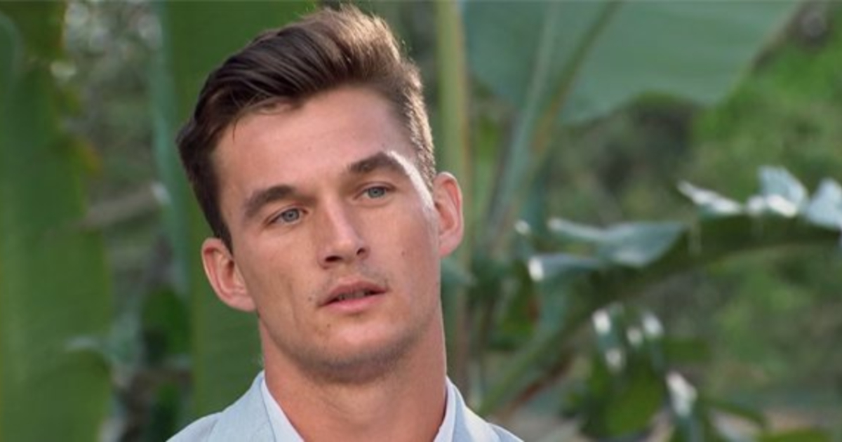 Tyler C. looking at Hannah B. during one of the final rose ceremonies on 'The Bachelorette'