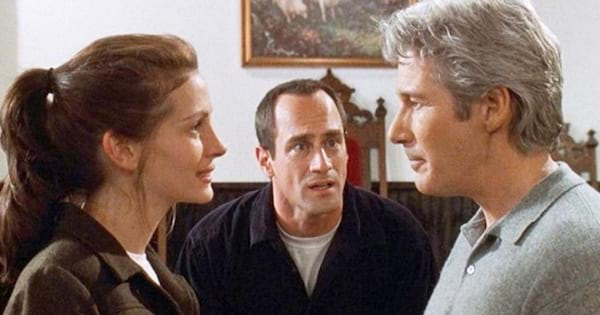 Julia Roberts as Maggie talking to Richard Gere as Ike as Cheristopher Meloni as Bob watches on in a scene from 'Runaway Bride'