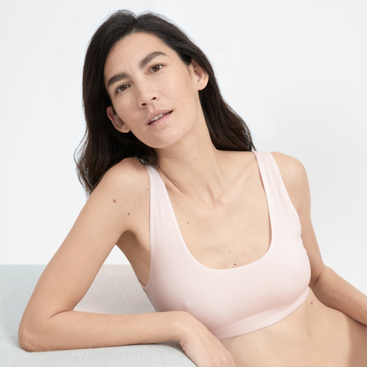 Woman modeling a pink Everlane The Tank Bra