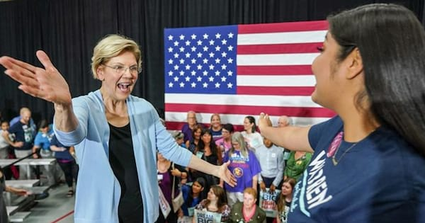 Elizabeth Warren hugging one of her grassroots supporters at a rally