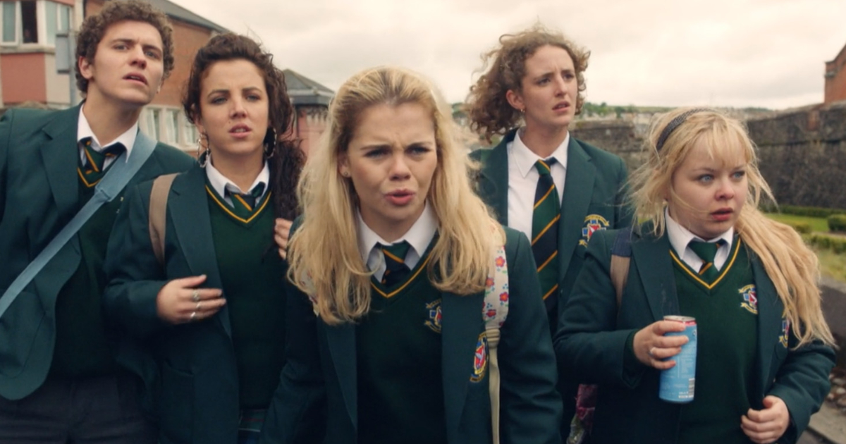 The main characters of Derry Girls walking to school