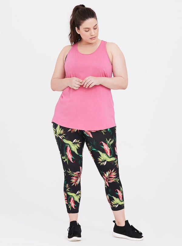 Woman wearing a Tropical Active Set from Torrid