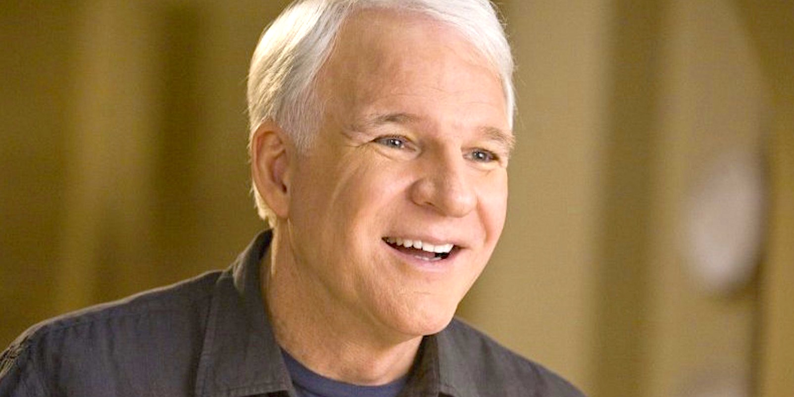 Steve Martin smiling in a scene from It's Complicated