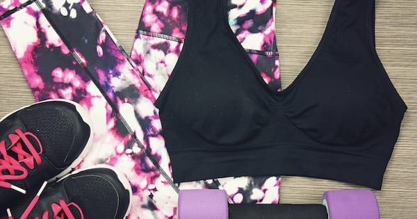 Women's sport wear and Dumbbell. Fitness wear and equipment. Sport accessories and fashion, Healthy lifestyle.