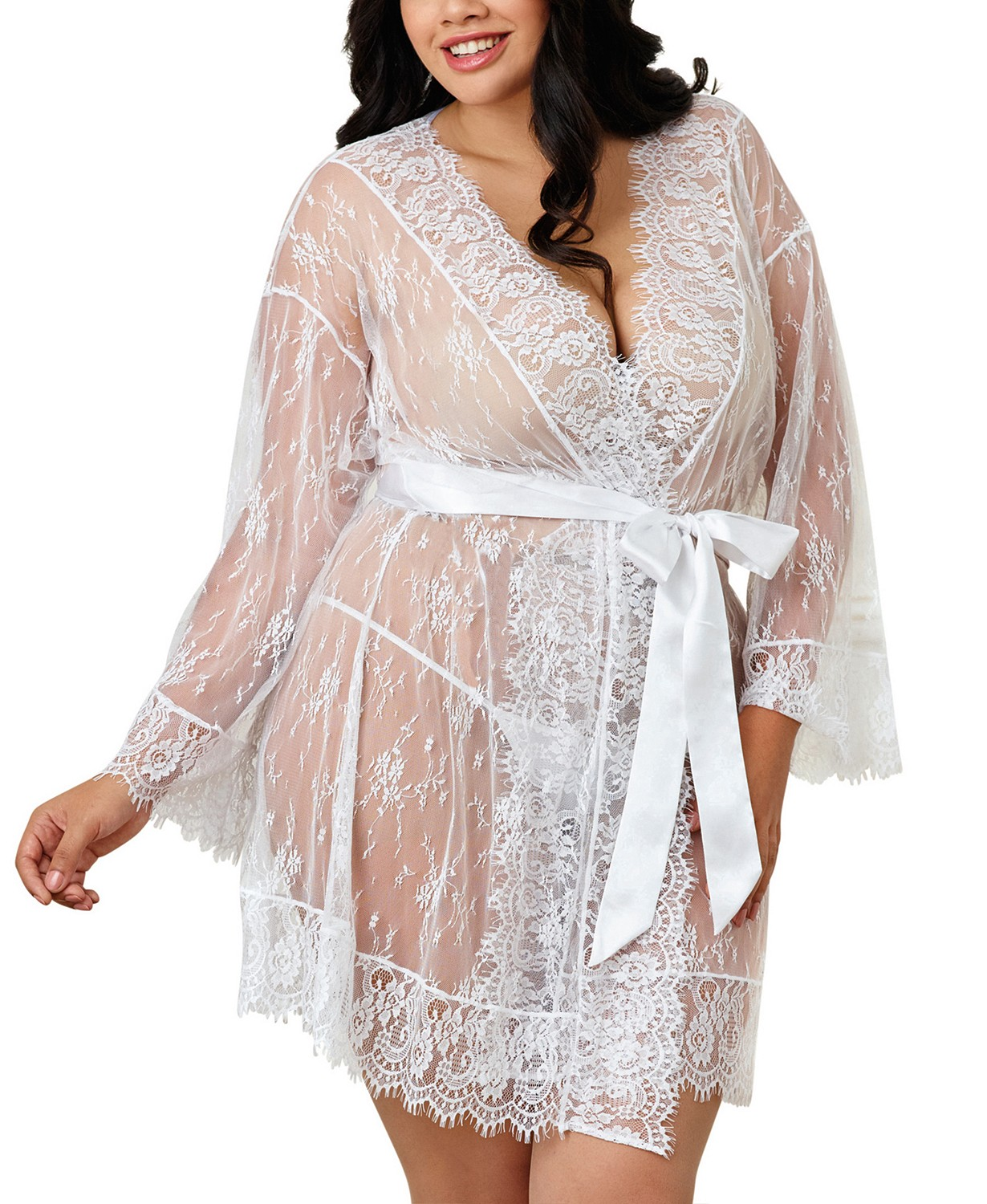 Woman modeling the Dreamgirl Plus-Size Lace Kimono Robe in white from Macy's