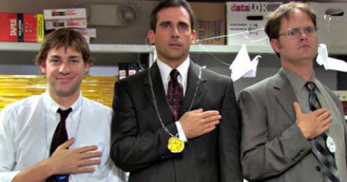 jim, Michael, and Dwight standing on a podium for the closing ceremony of The Office olympics