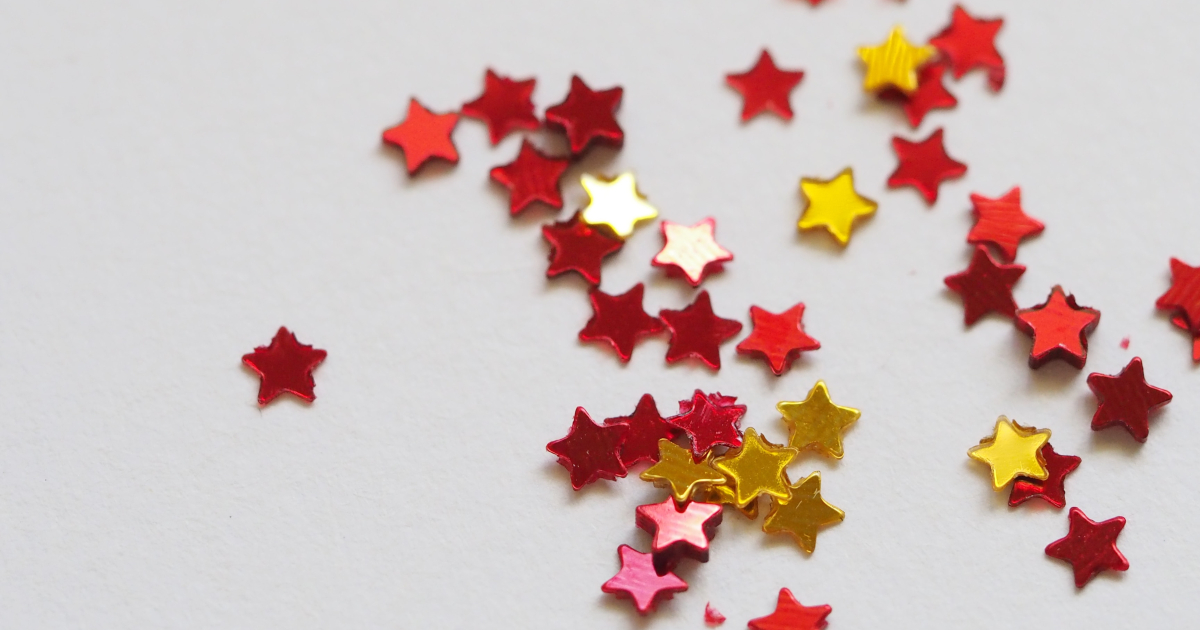 Yellow and red stars laid out on a white table