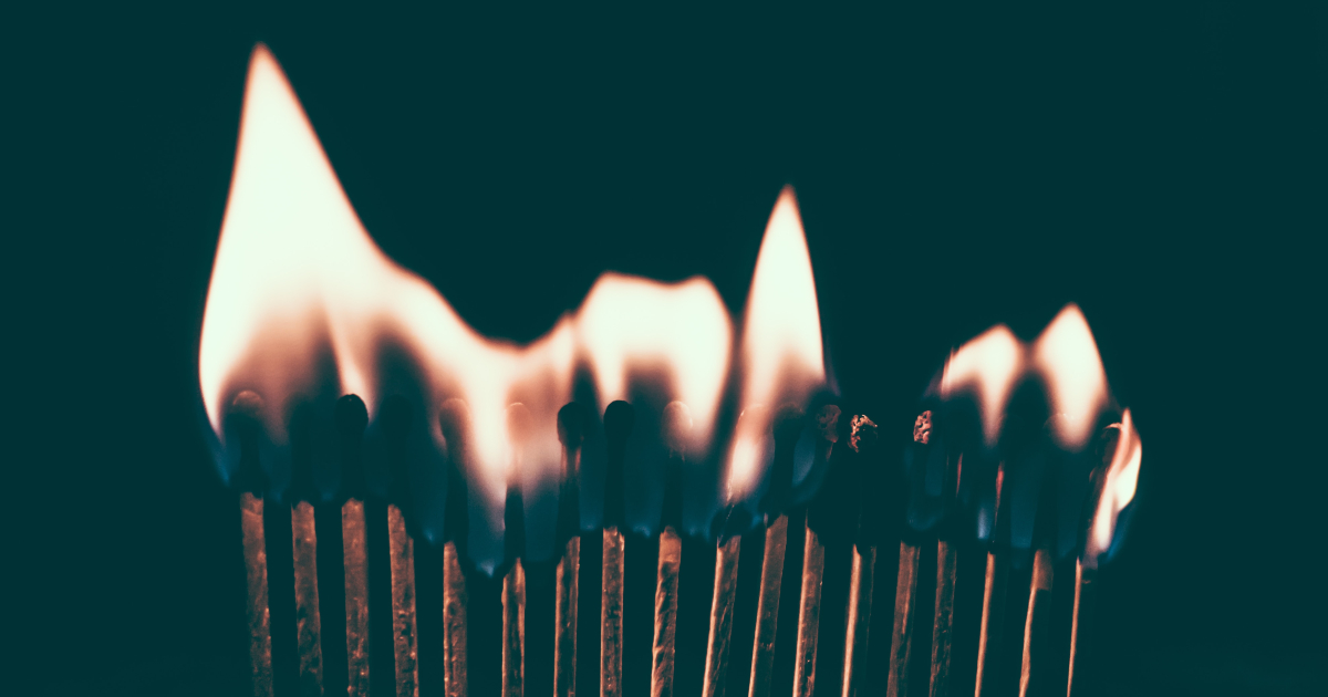 A row of matches all burning