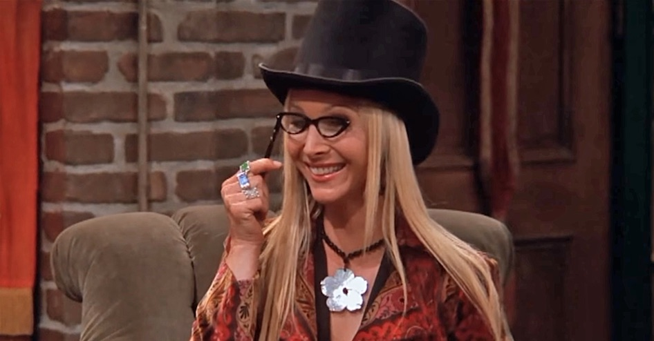 phoebe buffay on friends wearing top hat and glasses