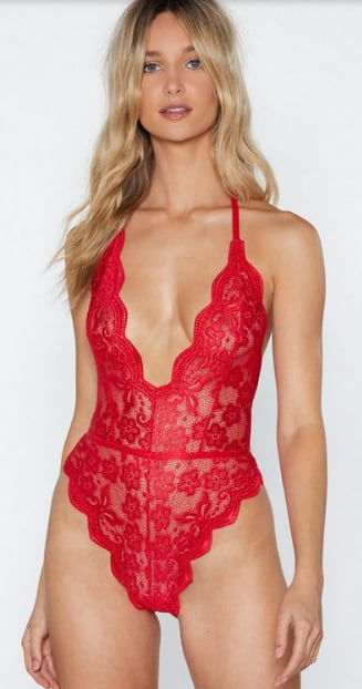 Woman wearing the V Lacey Halter Bodysuit from Nasty Gal