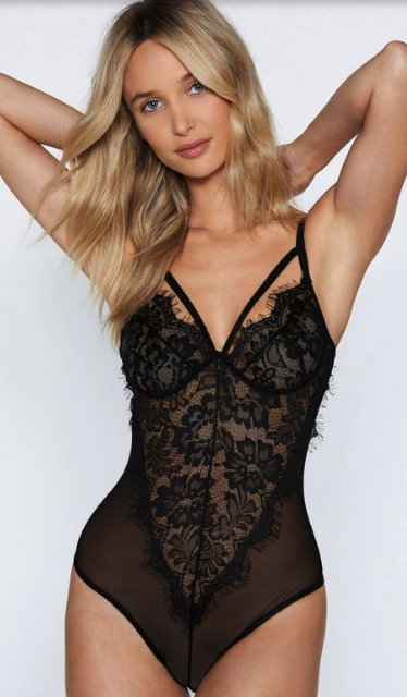 Woman wearing the I'm Into You Lace Bodysuit from Nasty Gal