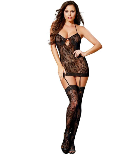 Woman wearing the Dreamgirl All-In-One Lace Mini Dress and Stockings from Lovehoney