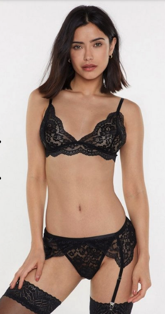Woman wearing the Suspender Until Further Notice 3-Piece Lingerie Set from Nasty Gal