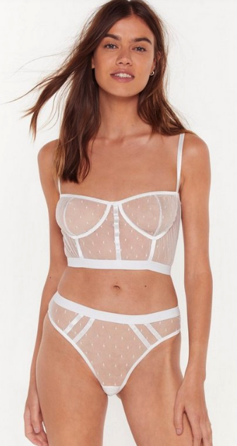 Woman wearing the Mesh It Up Bralette and Panty Set from Nasty Gal