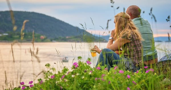 romance novels with older couples, a white man and woman sit overlooking the beach, books
