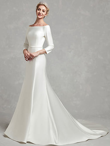 Woman wearing a Meghan Markle style wedding gown from Light in the Box