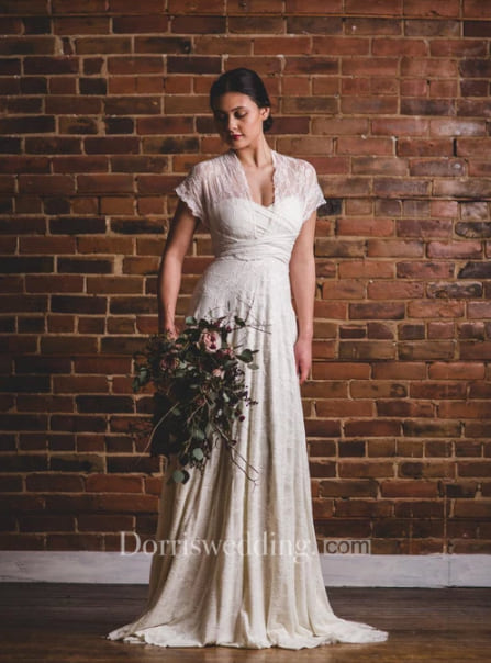 Woman wearing the Florence Full Lace Overlay Infinity Convertible Wedding Gown Dress from Dorris Wedding