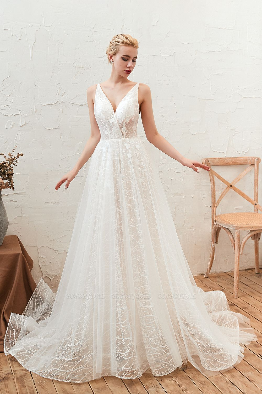 Woman wearing the Affordable Tulle V Neck Appliques Long Wedding Dress from BM Bridal