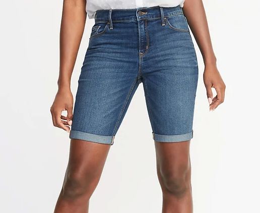 Woman wearing the Mid-Rise Slim Jean Bermuda Shorts from Old Navy