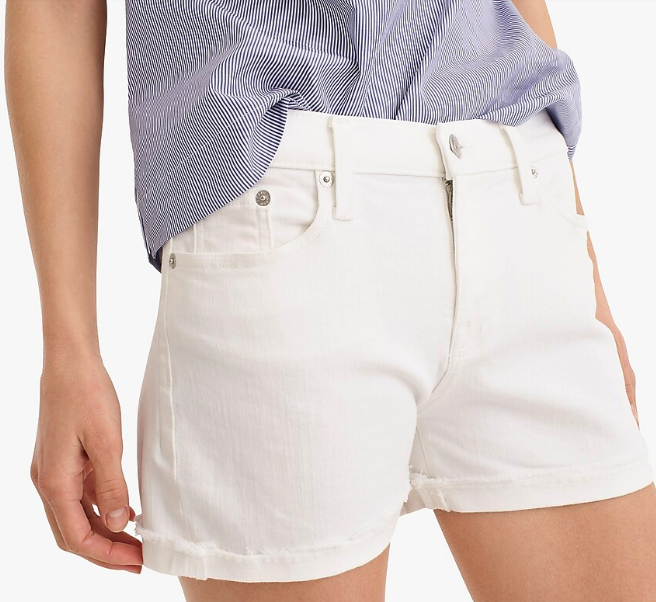 Woman wearing denim shorts in white from J. Crew
